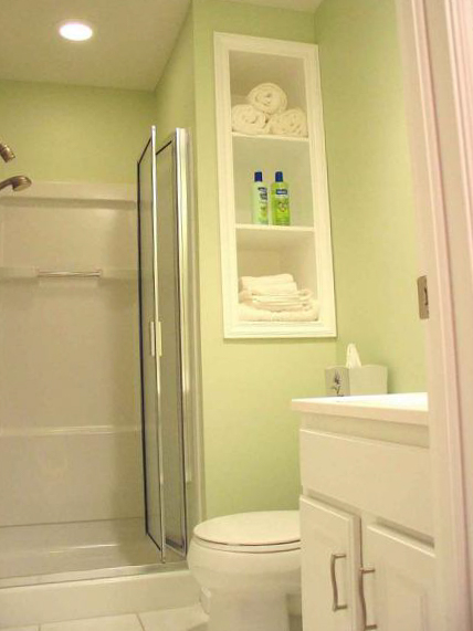 White furniture in a small bathroom