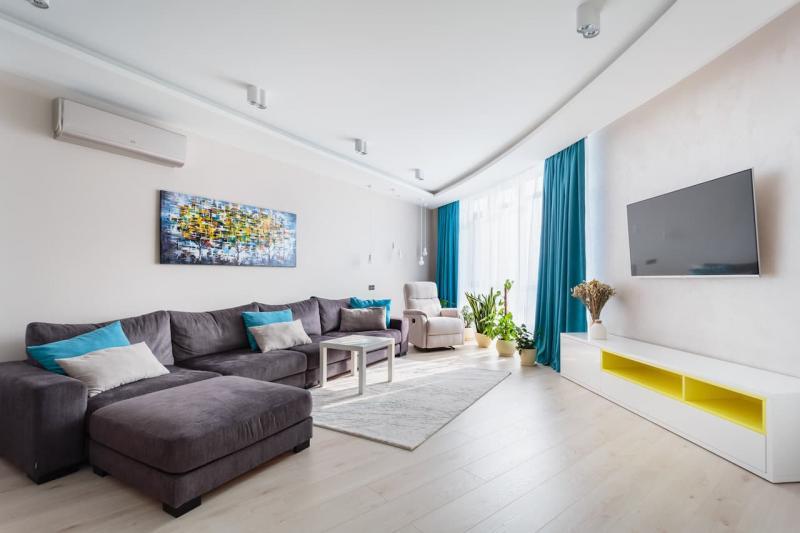 Практичный интерьер гостиной 4